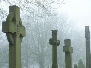 Foggy cemetery with tombstones