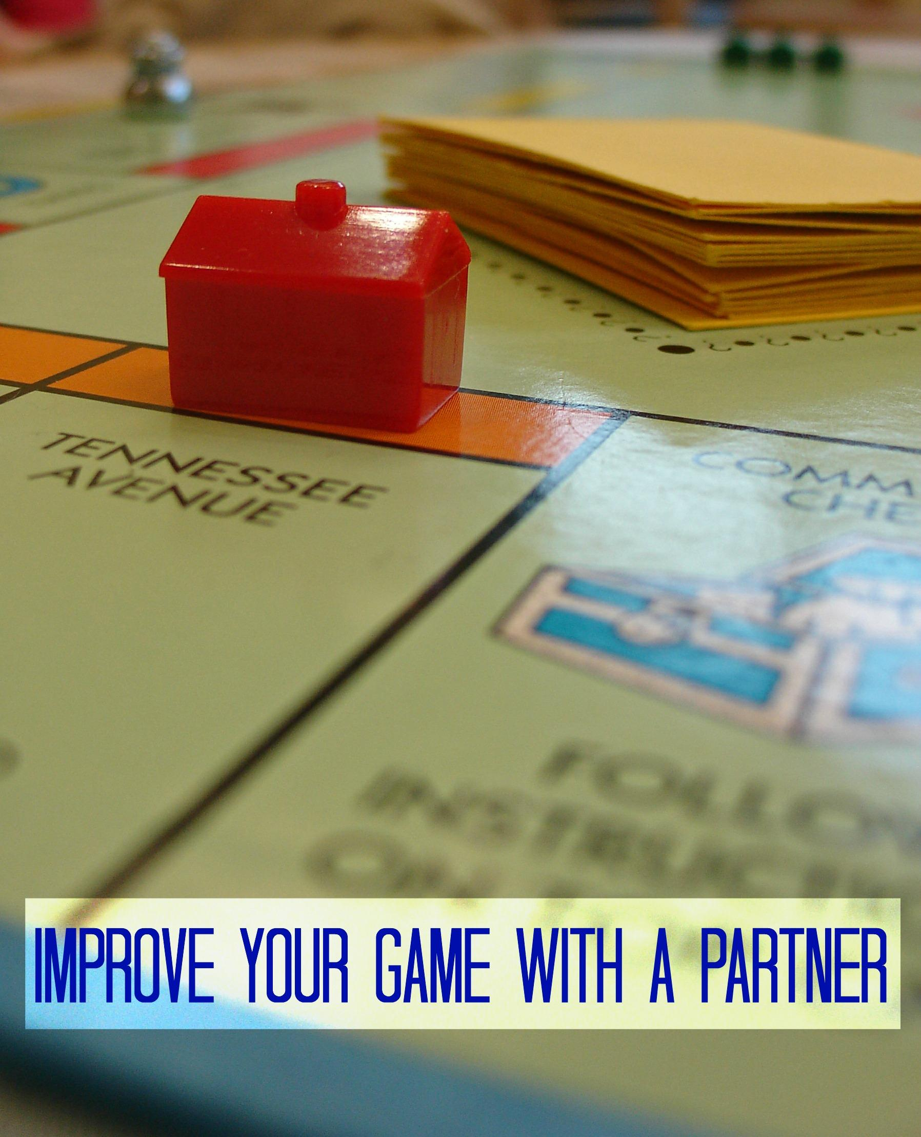 Monopoly Board with Improve Your Game with a partner
