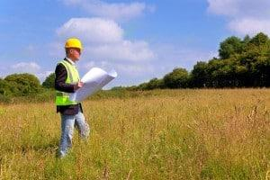 Builder or Developer looking at site plans for new Project