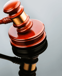 Auction gavel representing selling a client's land at an auction
